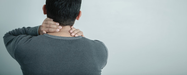 pain in the neck; medical concept, back view