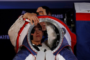 Advanced Space Suit Engineer at NASA Kristine Davis gets into the xEMU prototype space suit for the next astronaut to the moon by 2024, during its presentation at NASA headquarters in Washington