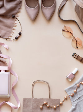 Fashion women stylish accessories outfit glamour set on flat lay beige pastel vertical background table with copy mock up space, female clothing shopping sale concept, top view overhead close up