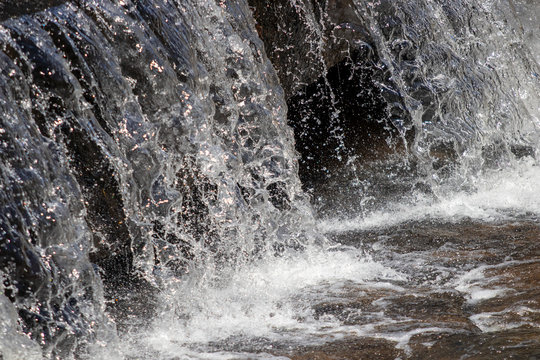 Waterfall close up with splashing and droplets
