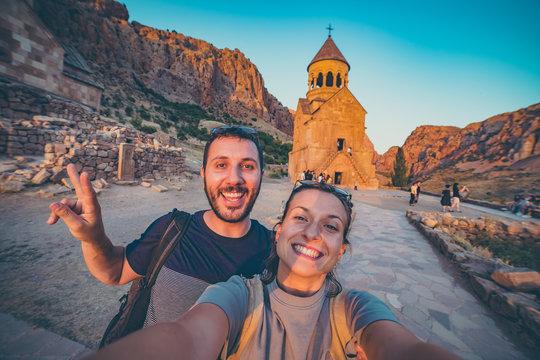 Noravank monastery, Armenia. Happy couple travelling in Armenia taking selfie in Novarank