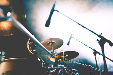 Live music and nigth concert background.Abstract image of drum on stage and smoke illuminated by spotlights