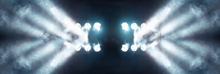 Stage lights and fog or misty in the dark.Musical background.Set of lights. Concept of live music and concerts.