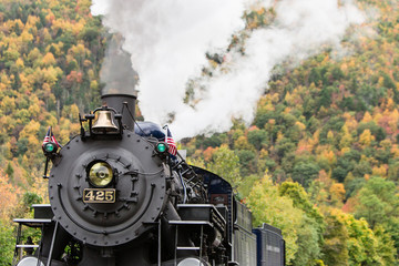 old steam engine fall foliage background