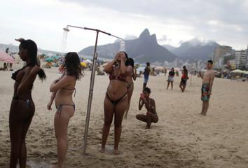 People refresh themselves at Ipanema beach in Rio de Janeiro