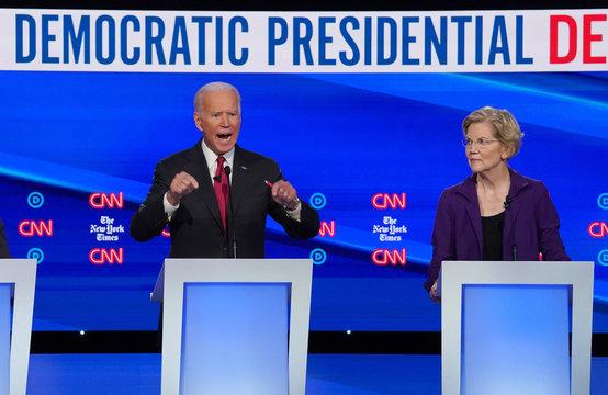 Democratic presidential candidate Senator Elizabeth Warren listens as former Vice President Joe Biden makes a point during the fourth U.S. Democratic presidential candidates 2020 election debate in Westerville, Ohio