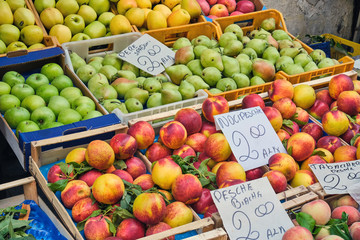 Apples and peaches for sale at a market in Naples, Italy