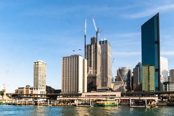 Canvas Prints Sydney Sunny day over Sydney business district skyline and the Circular Quay ferry terminal in Sydney, Australia largest city