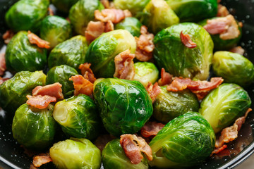 Acrylic Prints Brussels Frying pan of tasty roasted Brussels sprouts with bacon, closeup