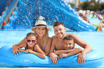 Tuinposter Amusementspark Happy family resting in aqua park