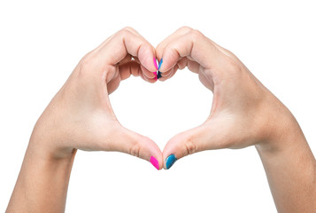 Close-up of a woman's hand showing heart sign with a pink and blue nail polish isolated on a white background.