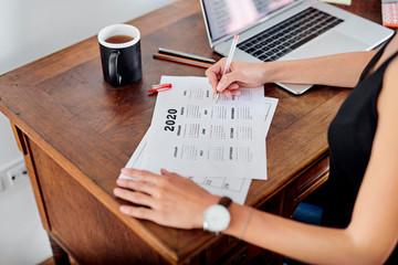 Girl making business calendar for year 2020