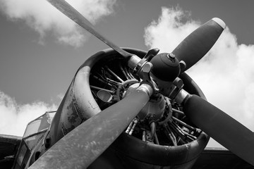 Propeller and engine of the old Soviet biplane. Black and white photo