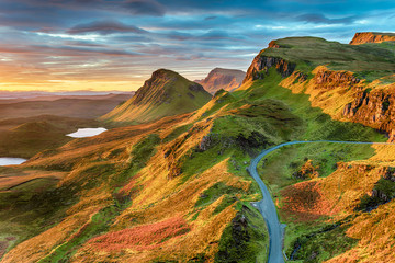 Beautiful sunrise sky over rock formations on the Quiraing