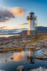 Fotobehang Blauw Sunset at Rhue Lighthouse