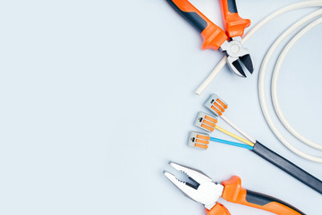 Electric Tools And Equipment On Grey Background With Copy Space.