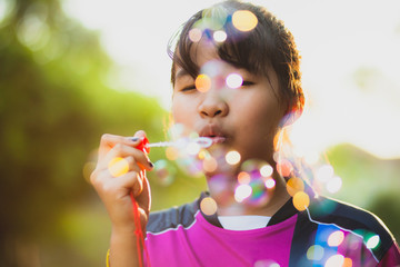 asian teenager relaxing with soup bubble