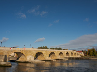 The Stone Bridge in Regensburg, Bavaria on a sunny day in October
