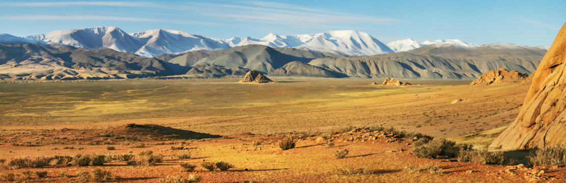 Typical landscapes of Mongolia. Snow on the peaks, desert mountain slopes and valleys.