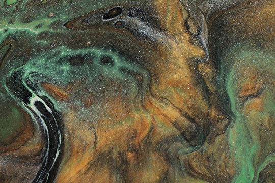 Earth tones of brown, green, black, white, shimmery silver, and glittering gold combine to form this flowing and organic abstract background.