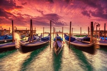 Foto auf Leinwand Venedig Gondolas moored by Saint Mark square, Venice, Italy, Europe.