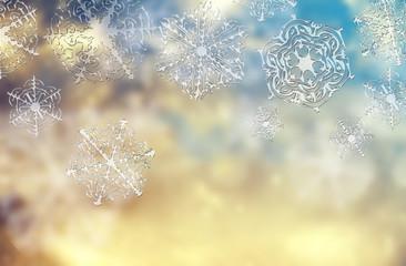 Blue golden magic shiny christmas background with white subtle snowflakes