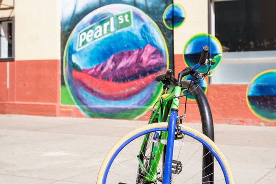 Boulder, Colorado, USA-September 27, 2019. street view of Colorful bike in front of Pearl Street wall mural