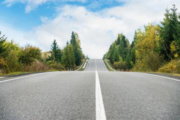 Emptu asphalt road in mountains - fototapety na wymiar