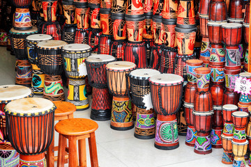 Wide range of colorful djembe drums at souvenir shop
