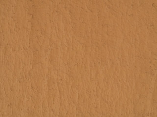 texture of a clay wall form a mud house