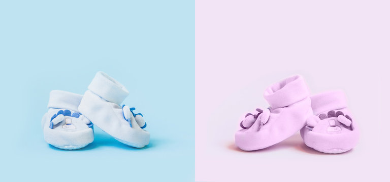 Newborn flat lay postcard. Baby booties shoes for boy and girl on a blue pink background. Congratulations on the birth of a newborn baby with copy space.