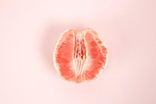 half peeled grapefruit