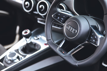 LONDON - JUNE 26, 2015: Audi TT car sports steering wheel and interior dashboard