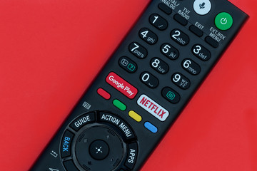 LONDON - APRIL 06, 2018: Netflix button on television remote control