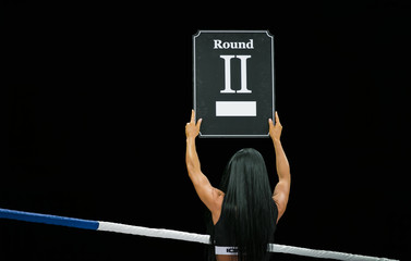ring girl hold hands display in number of upcoming round