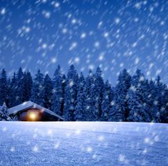 Wall Mural - Blockhütte mit Leuchtendem Fenster in Winterwald