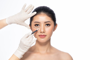 Lines on face, close up, plastic surgery concept, doctor's hand in glove making marks on patient's face..Asian beauty  Woman in beauty salon. plastic surgery clinic.