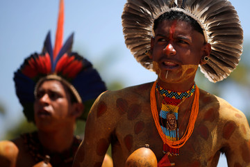 Indigenous people from ethnic groups Pataxo and Tupinamba attend a protest to defend indigenous land, outside Brazil's Supreme Federal Court in Brasilia
