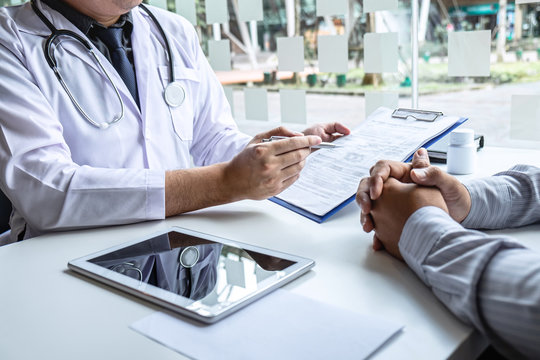 Doctor having conversation with patient while discussing explaining symptom