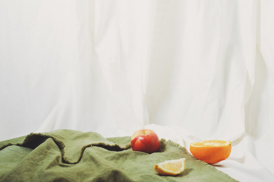 Still life with apple and halved orange