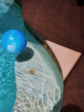 Giant blue ball in swimming pool