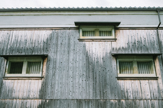 Low angle view of weathered wooden house