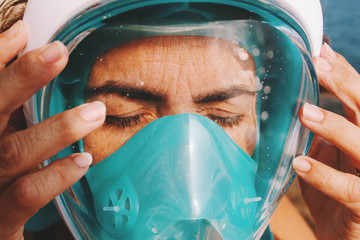 Close up view of ocean diver in diving headgear