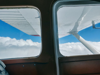 View of clouds from airplane interior