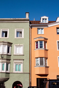 Two colorful stucco buildings