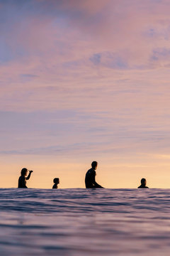 Surfers waiting for a wave in the ocean