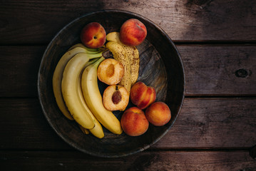 Overhead view of fruits bowl on wooden table