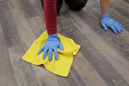 Hand in glove cleaning laminate floor