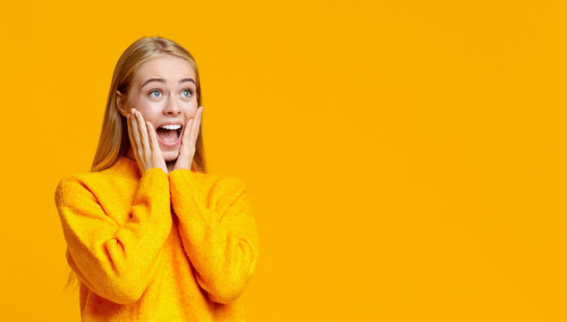 Shocked girl looking at copy space with amazement