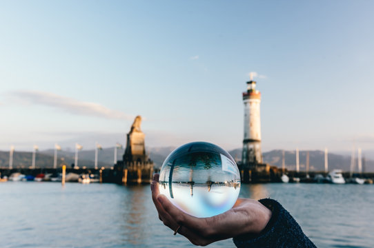 Reflection of the famous waterfront of Lindau in a crystal ball, Lindau, Bodensee, Germany